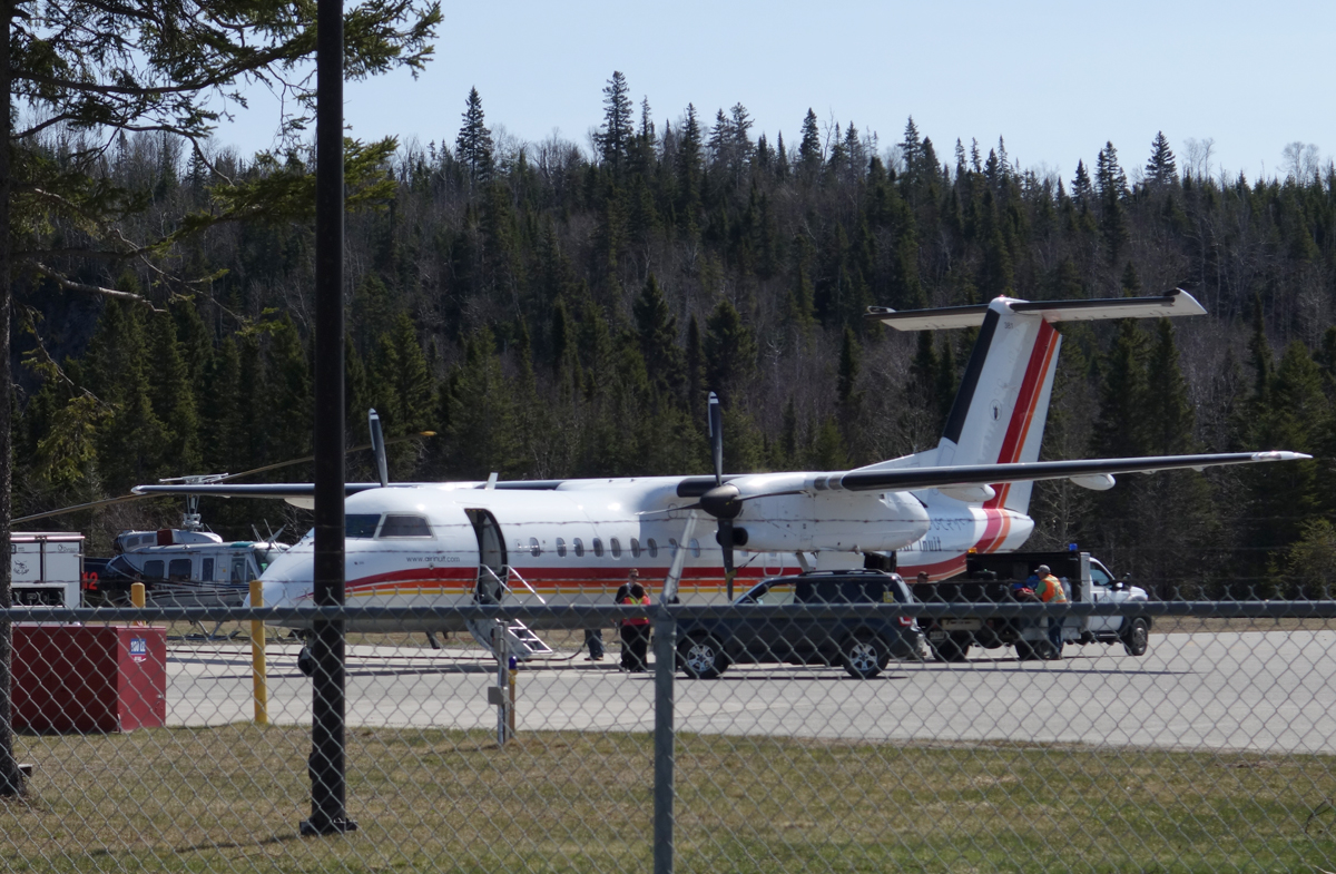 Municipal staff fuelling and loading aircraft prior to boarding and departure.