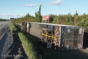 MyWawa.ca photographer Marcus Grundt captured this image around 8:30 p.m. Saturday, June 11. A tractor trailer (Arnold Brothers) was laying on its side in the ditch.