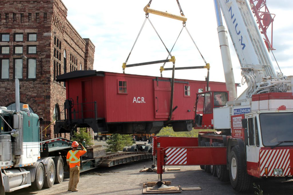 Swinging the boxcar off the float and towards it's new home.