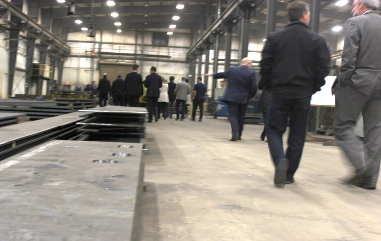 The delegation tours SIS Group.